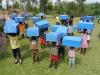 Children excited to receive their own storage box